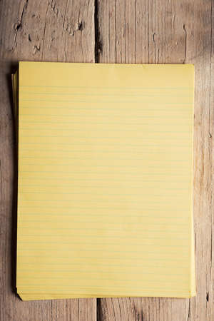 Blank notepaper on raw unpainted hardwood sidelight photo