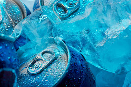 aluminum can: Macro shot of frozen drink cans and ice