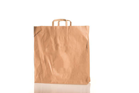 Bpank paper bag isolated on white with glass floor photo