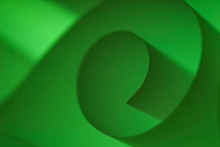 Green paper spiral closeup in studio backlit photo