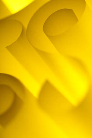 Abstract design paper spirals closeup backlit yellow photo