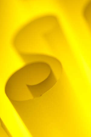 Blank yellow design paper curled up with soft light photo