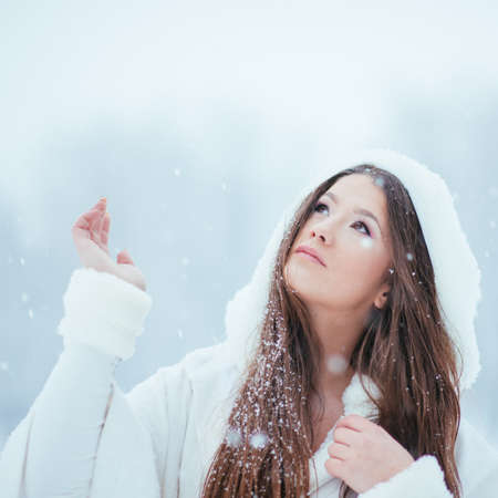 Girl enjoying the first snowflakes in late december