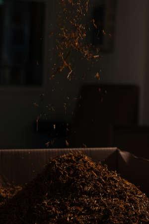 Fine cut tobacco background falling down