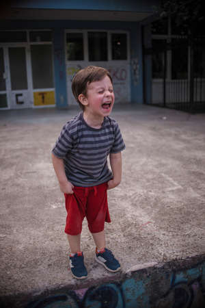 Small boy yelling in the playground