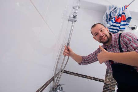 Handyman preparing to repair the bath tub giving thumbs up