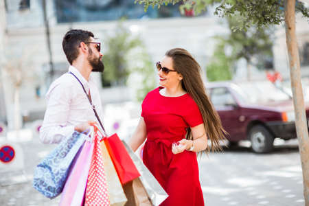 Shopping in the city.Lovely couple having fun on the Macedonian streets,on a sunshine day. Stock Photo
