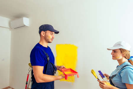 Fresh coat of paint on a new apartment for a young Caucasian couple