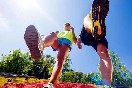 Couple with running sneakers on stairs while jogging Stock Photo
