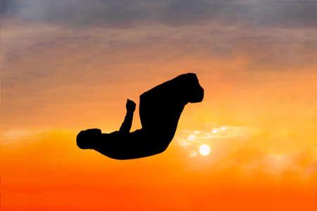 Fitness man doing parkour sport at sunset Stock Photo