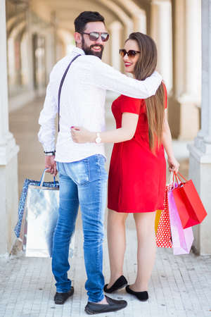 Shopping in the down town.Lovely couple having fun on the Macedonian streets, on a sunshine day. 写真素材