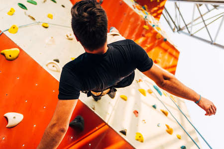 Active lifestyle and bouldering climbing, reaching the top concept