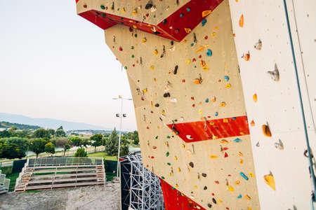 Outdoor rock climbing wall in a sport facility Stock Photo