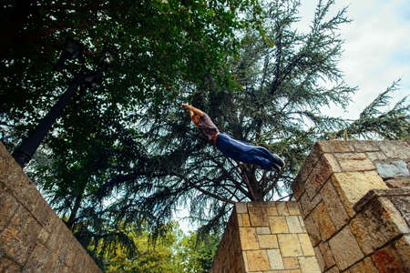 Free runner jumping from wall while training parkour