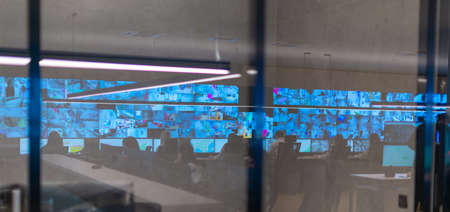 Reflection of a security agency team working at the data center Banque d'images