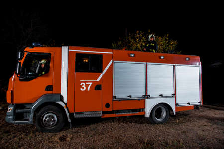 Fire brigade during operation in the field at night time