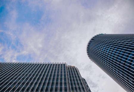 Looking up to skyscrapers and office buildings from below in metropolitan city