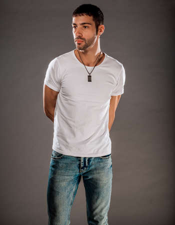 Studio body shot of a fashion male model wearing stylish clothes