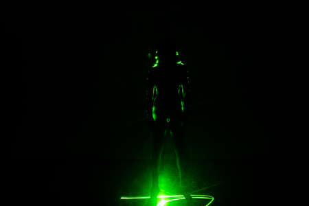 Shape of a contemporary dancing performer in a dance laser show