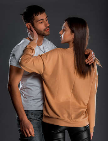 Portrait of young male and female models hugging passionately Stock fotó