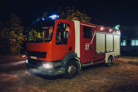 Fire truck with flashing lights during a firefighting operation