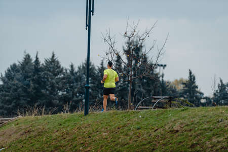 Well built middle aged athlete during a running exercise