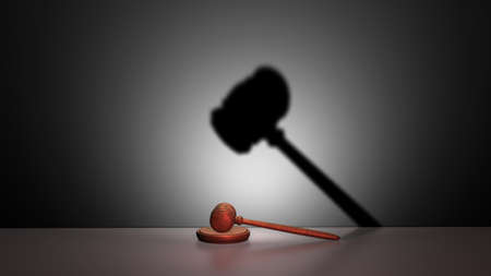 fateful: A gavel and its strange shadow Stock Photo
