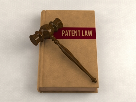 patent: Gavel on a patent law book. Conceptual illustration