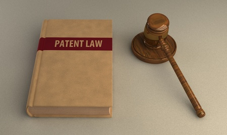patent: Gavel and patent law book on linen surface. Conceptual illustration