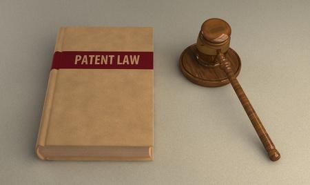marca libros: Mazo y libro de la ley de patentes en la superficie de lino. Ilustración conceptual