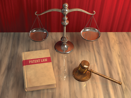 Illustration of legal attributes: gavel, scale and patent law book on the table illustration