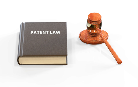 patent: llustration of legal attributes: gavel and patent law book on the white with shadows. Actual theme in modern business
