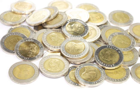many of ten baht coins isolated on white background  photo