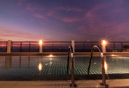 Swimming pool in twilight sky photo