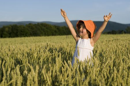 Happy liitle girl in the field photo