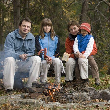 Happy family  near campfire Stock Photo - 3765375