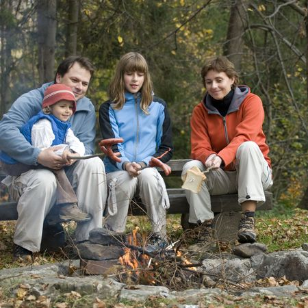 Happy family  near campfire