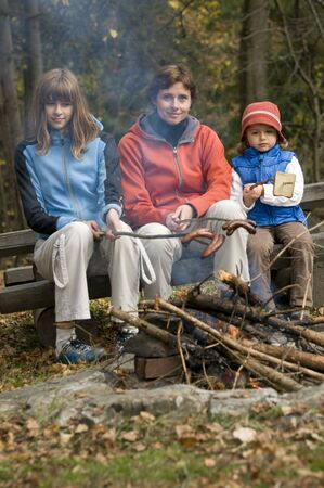 Mother and daughters near campfire Stock Photo - 3765387