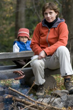 Mother and daughter near campfire Stock Photo - 3765379