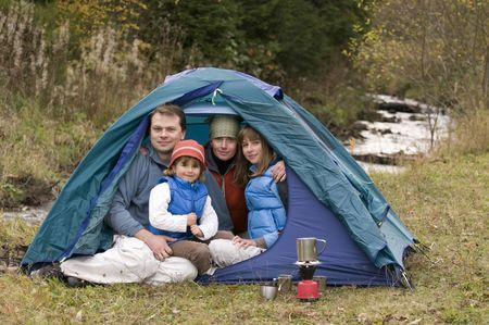 Happy family camping in tent Stock Photo - 3765445