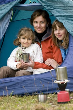 Mother and daughters camping in tent Stock Photo - 3765382
