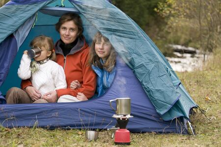 Mother and daughters camping in tent Stock Photo - 3765399