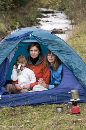 Mother and daughters camping in tent Stock Photo - 3765388