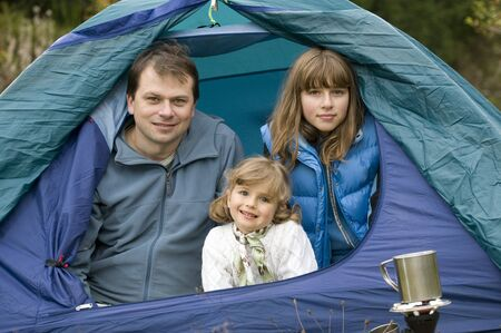 Father with daugters camping in tent Stock Photo - 3765398