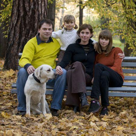 Happy family at autumn time Stock Photo