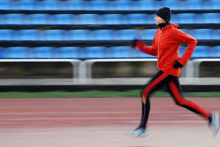 Woman running on the track