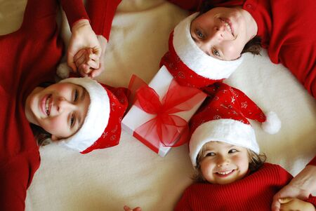 Happy  family at Christmas time photo