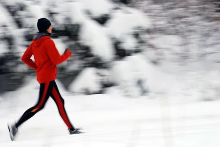 Winter jogging, intentional motion blur Stock Photo