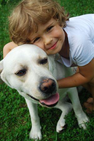 Little girl with labrador retriever