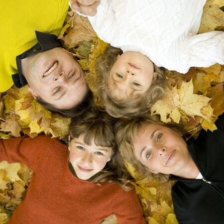 Happy family at autumn time photo